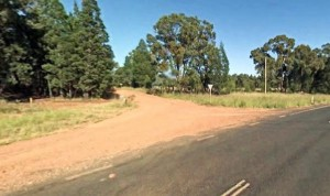 rural-dirt-road-joins-main-road