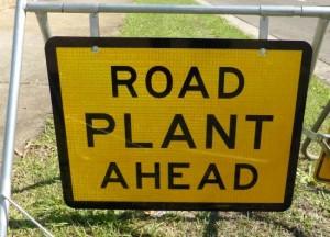 road plant ahead sign