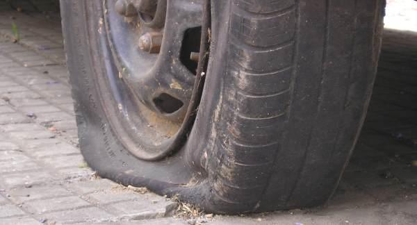 flat tyre on rim