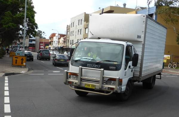 truck turning right at a crossroads