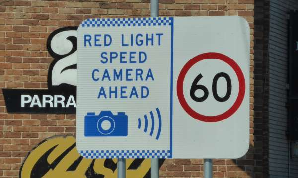 Sign for red light speed camera ahead in a 60kph zone