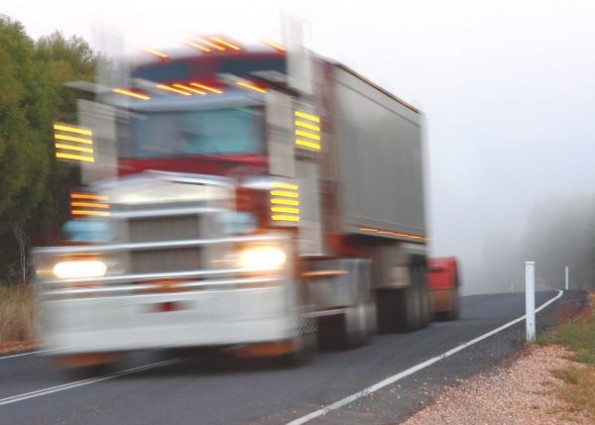 truck on rural road at speed