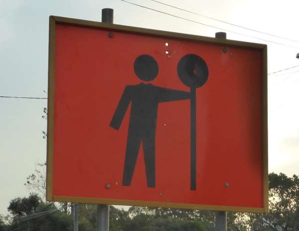traffic controller ahead sign