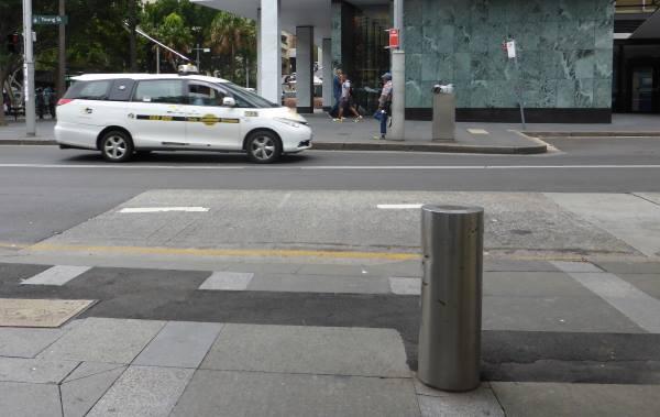 bollard with taxi