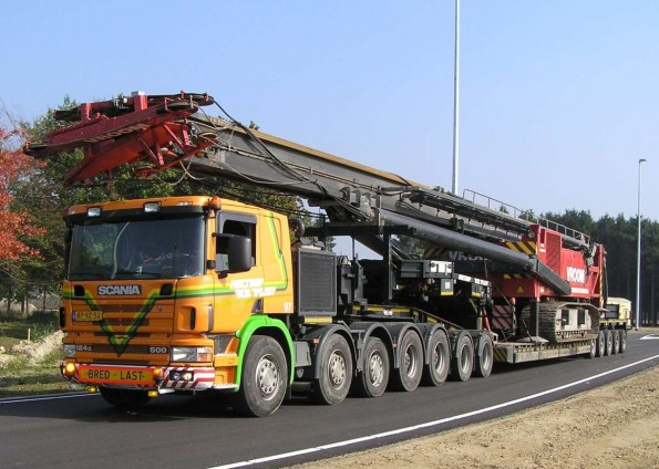 Heavy crane being transported on a lowboy trailer