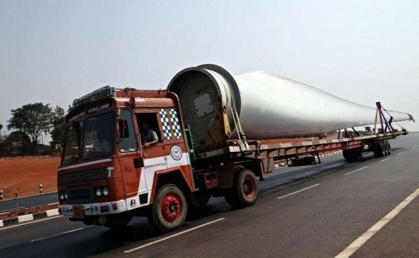 Flat-bed truck carrying a wind turbine. This is a long load