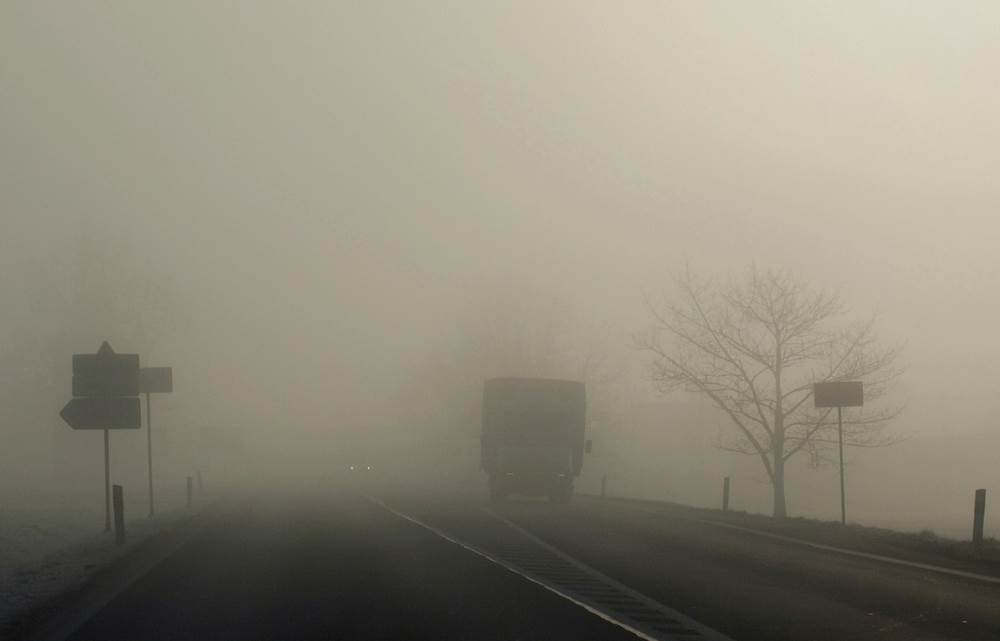 foggy road with approaching truck