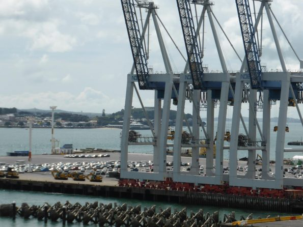 Behind the cranes you'll see vehicle storage at Ports of Auckland at Captain Cook Wharf.